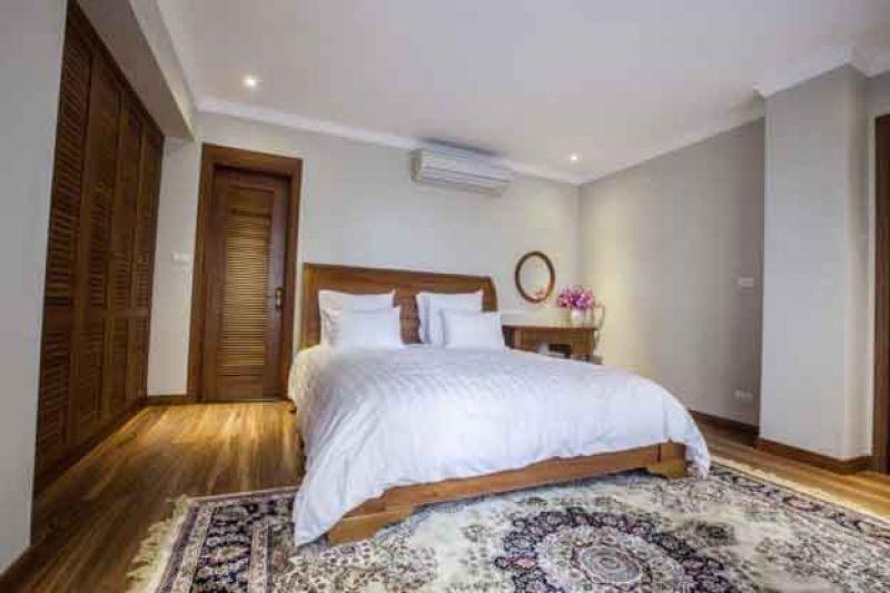 Điều hòa không nên đặt ở đầu giường, chân giường hoặc bức tường bên cạnh giường.